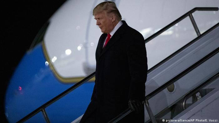 US President Donald Trump arrives for a rally in Battle Creek, Michigan which coincided with the vote for his impeachment
