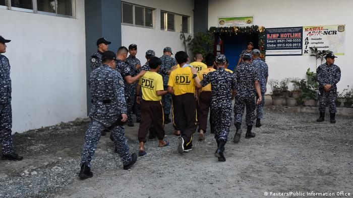 Some of those accused in the 2009 Maguindanao massacre are escorted to attend the case in this December 19 picture (Reuters/Public Information Office)