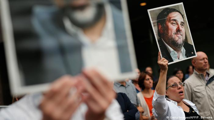A woman holds a placard depecting a picture of jailed Catalan separatist leader Oriol Junqueras