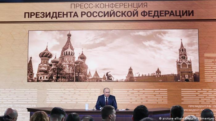 Russian President Vladimir Putin talks to the media during his annual news conference in Moscow, Russia