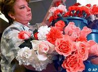 Florist arranges bouquet of flowers