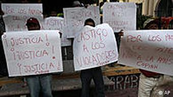 Supporters of Honduras' ousted President Manuel Zelaya protest an amnesty law outside Congress in Tegucigalpa, Tuesday, Jan. 26, 2010. The signs read in Spanish Justice!, left, Punishment to the violators, center, and For the martyrs of the coup, not for amnesty, right. Honduras' President-elect Porfirio Lobo will be sworn in on Jan. 27, the final day of ousted President Manuel Zelaya's term. (AP Photo/Esteban Felix)