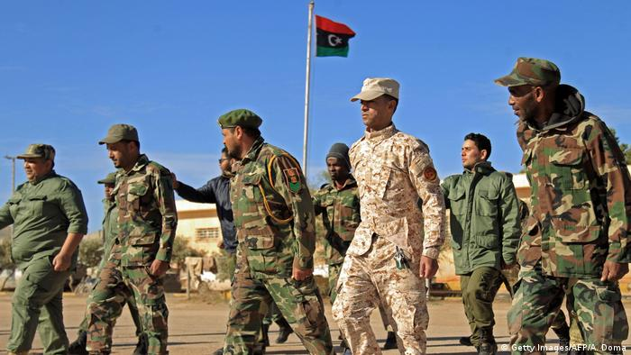Fighters of a military battalion loyal to Libyan General Khalifa Haftar march during the morning assembly in the eastern city of Benghazi