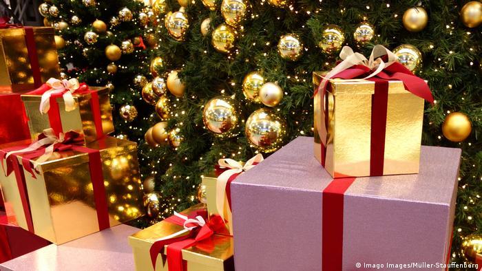 Christmas presents sat around a Christmas tree