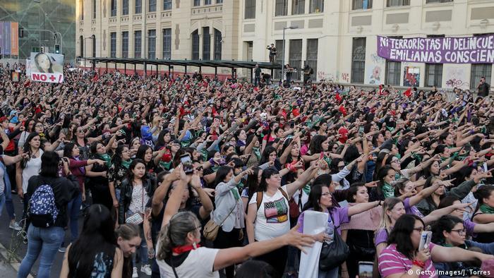 Protesters demonstrating against gender-based violence in Santiago in December 2019