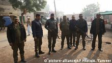 Pakistani police officers stand guard outside Multan jail after a court's decision for a professor facing blasphemy case, in Multan, Pakistan, Saturday, Dec. 21, 2019. A Pakistani court on Saturday convicted the Muslim professor of blasphemy, sentencing him to death for allegedly spreading anti-Islamic ideas. Junaid Hafeez has been held for six years awaiting trial. He's spent most of that time in solitary confinement because he would likely be killed if left with the general population, local media have reported. (AP Photo/Asim Tanveer) |