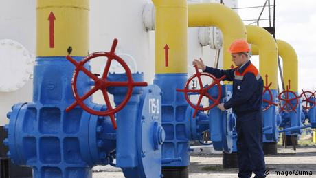 A Ukrainian worker checks gas valves of the main natural gas pipeline at the gas-compressor station in Boyarka village