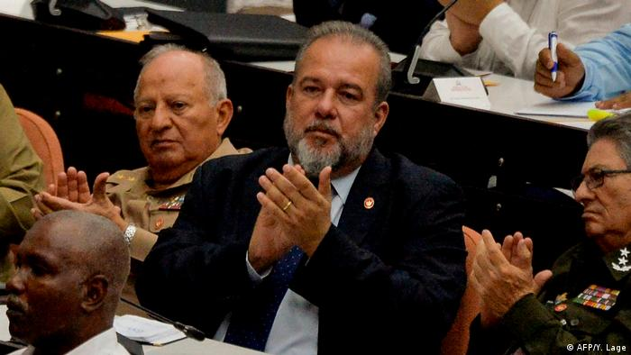 Newly-appointed Cuban prime minister Manuel Marrero Cruz, center, attends a National Assembly session in Havana, on Saturday.