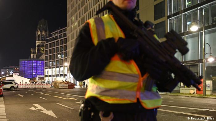 A policeman with gun near the Christmas market