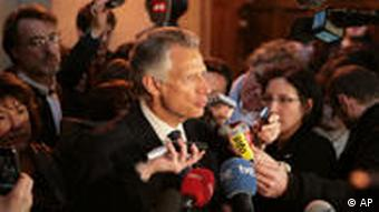 Villepin surrounded by media
