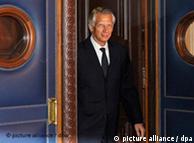 Dominique de Villepin, walks though door