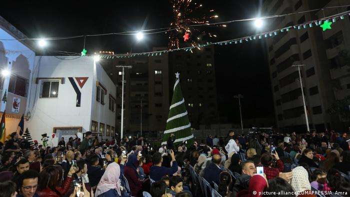Christians in Gaza celebrate the Christmas season with a tree lighting ceremony