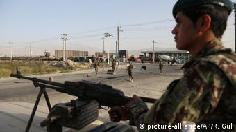 An Afghan soldier stands at a checkpoint