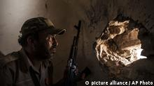 A fighter of the Libyan forces, affiliated to the Tripoli government scans for targets, from the minaret of a mosque retake from Islamic State control, in Sirte, Libya, Thursday, Sept. 22, 2016. The new offensive to retake the last district under control of Islamic State militants has left over over 5 Libyan fighters dead and wounded around 70. (AP Photo/Manu Brabo) |