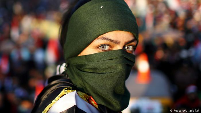An Iraqi female demonstrator takes part in ongoing anti-government protests in Baghdad (REUTERS/Ahmed Jadallah)