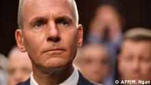 (FILES) In this file photo taken on October 29, 2019 Boeing president and CEO, Dennis Muilenburg arrives for a full committee hearing on Aviation Safety and the Future of Boeing's 737 MAX on Capitol Hill in Washington,DC. - Boeing on December 23, 2019 replaced its embattled chief executive, Dennis Muilenburg, saying a change was needed as it attempts to restore its reputation amid the protracted 737 MAX crisis. Boeing named Chairman David Calhoun as its chief executive, saying the company needed to restore confidence and repair relationships with regulators, customers and all other stakeholders. (Photo by MANDEL NGAN / AFP)