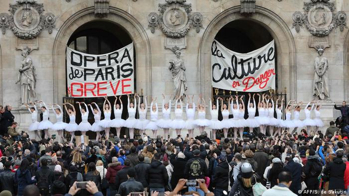 Ballerinas perform outside to protest the pension reforms