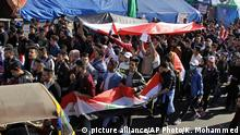 Anti-government protesters gather in Tahrir Square during a sit-in, Baghdad, Iraq, Tuesday, Dec. 24, 2019. (AP Photo/Khalid Mohammed) |