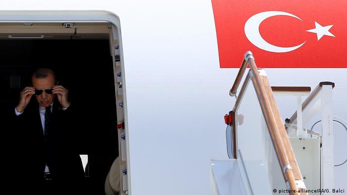 Turkish President Recep Tayyip Erdogan exits a government plane