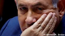 FILE PHOTO: Israeli Prime Minister Benjamin Netanyahu sits at the plenum at the Knesset, Israel's parliament, in Jerusalem May 30, 2019. REUTERS/Ronen Zvulun/File Photo