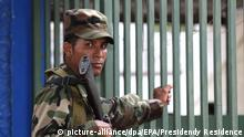 epa02221242 A handout photo provided by Salvadorean Presidency Residence shows a soldier standing guard outside the jail of Chalatenango, 72 kilometers from San Salvador, El Salvador, 24 June 2010. The Salvadorean Army has deployed soldiers to support the security in the most dangerous jails of the country. EPA/PRESIDENDY RESIDENCE HANDOUT NO SALES / EDITORIAL USE ONLY |