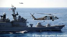 A Japan Maritime Self Defense Forces' helicopter flies beside Japanese destroyer Shirane during the 'Keen Sword', a US-Japan military exercise at the Pacific Ocean on December 10, 2010. The eight-day-long exercise which started on Decomber 3 ends on December 10 as around 10,500 US service members and their Japanese Self Defence Forces counterparts participated in. AFP PHOTO / TOSHIFUMI KITAMURA (Photo credit should read TOSHIFUMI KITAMURA/AFP via Getty Images)