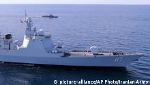In this photo provided Friday, Dec. 27, 2019, by the Iranian Army, two warships sail while approaching to the Iran's southeastern port city of Chahbahar, in the Gulf of Oman. Iran's navy on Friday kicked off the first joint naval drill with Russia and China in the northern part of the Indian Ocean. (Iranian Army via AP) |