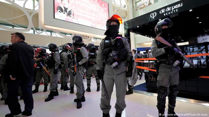 Hong Kong riot police gather at a shopping mall popular with traders from mainland China