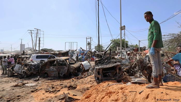 A Somali man stands at the scene of a car bomb explosion at a checkpoint in Mogadishu on December 28, 2019