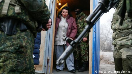 A prisoner guarded by pro-Russian separatists before a prisoner exchange in eastern Ukraine (Reuters/A. Ermochenko)