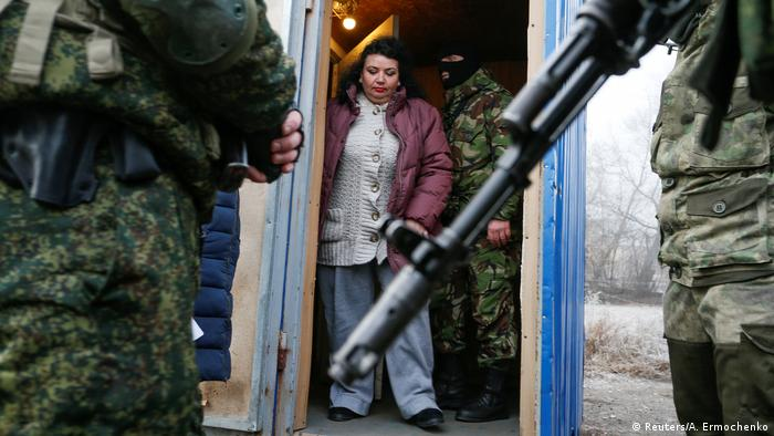 A prisoner guarded by pro-Russian separatists before a prisoner exchange in eastern Ukraine