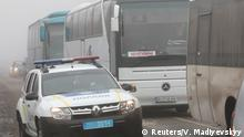 29.12.2019 A view shows buses for pro-Russian rebels, which are escorted by servicemen of the Ukrainian armed forces and policemen, before the exchange of prisoners of war (POWs) between Ukraine and the separatist republics near the Mayorsk crossing point in Donetsk region, Ukraine December 29, 2019. REUTERS/Vyacheslav Madiyevskyy