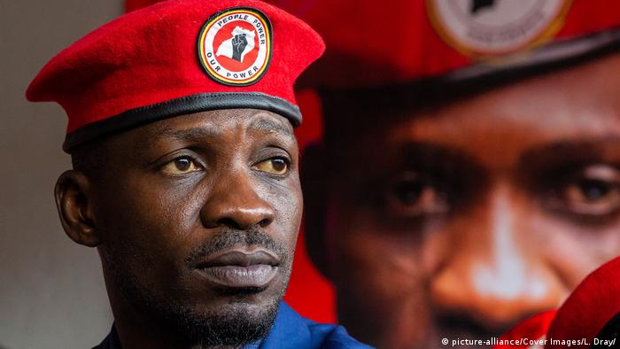 Bobi Wine in a red beret with the logo of his movement