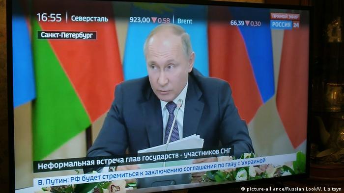 Tela de TV mostra Vladimir Putin