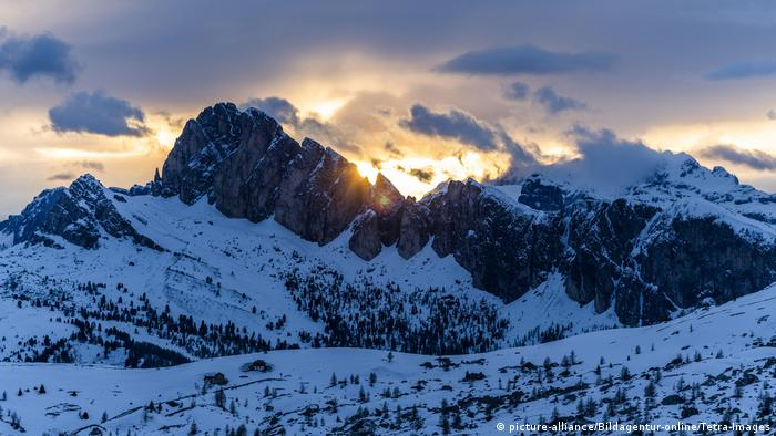 Mountain range in snow at sunset in Dolomites