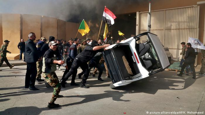 Protesters damage property inside the U.S. embassy compound