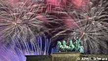 Fireworks explode behind the quadriga of Berlin's landmark Brandenburg Gate to usher in the New Year on January 1, 2020. (Photo by Tobias SCHWARZ / AFP)