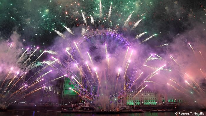 London fireworks display above London Eye (Reuters/T. Melville)
