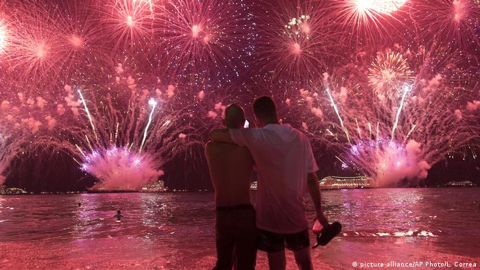 Two men watch fireworks at new year in Rio de Janeiro
