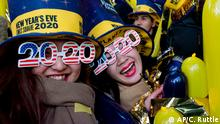 Revelers take part in New Year celebrations on Times Square in New York, Tuesday, Dec. 31, 2019. (AP Photo/Craig Ruttle)