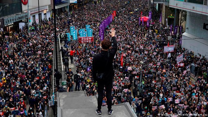 Thousands gather near a Hong Kong mall