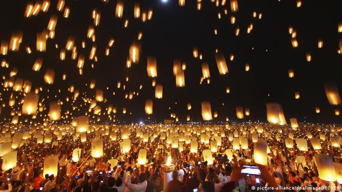 Sky lanterns float towards the sky in Myanmar