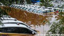 A fleet of flooded taxis are seen at the operator's submerged parking lot following overnight rain in Jakarta on January 1, 2020. - Nine people died after Indonesia's capital was hit by its deadliest flooding in years, authorities said January 1, as torrential rains on New Year's Eve left vast swathes of the megalopolis submerged. (Photo by RALIA / AFP) (Photo by RALIA/AFP via Getty Images)