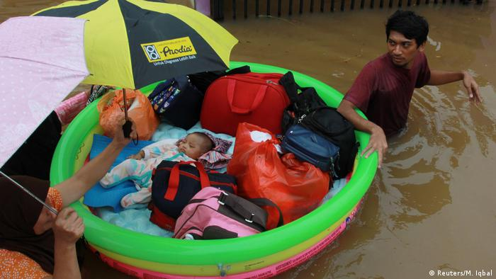 Residents were forced to use inflatables to evacuate children and salvage belongings. Floodwaters rose an estimated 2.5 meters (8 feet) in some areas. The floods forced authorities to cut off electricity and water, and paralyzed transport networks.