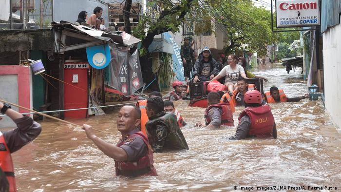 Rescue workers evacuating residents from flooding in Jakarta
