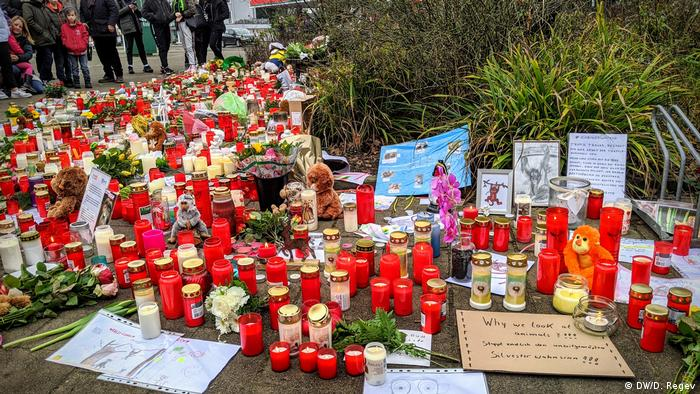 A memorial of candles, cards and signs to honor the dead animals at Krefeld Zoo
