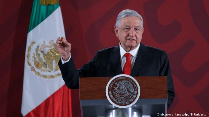 Mexico's president Lopez Obrador in front of a national flag during a news conference in the presidential palce