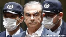 FILE - In this April 25, 2019, file photo, former Nissan Chairman Carlos Ghosn leaves Tokyo's Detention Center for bail in Tokyo. By jumping bail, Ghosn, who had long insisted on his innocence, has now committed a clear crime and can never return to Japan without going to jail. (Kyodo News via AP, File) |
