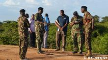 2.1.2020*** Kenyan police officers are seen near the scene where armed assailants killed three people and injured two others in Nyongoro area of Lamu county, Kenya January 2, 2020. REUTERS/Stringer NO RESALES. NO ARCHIVES