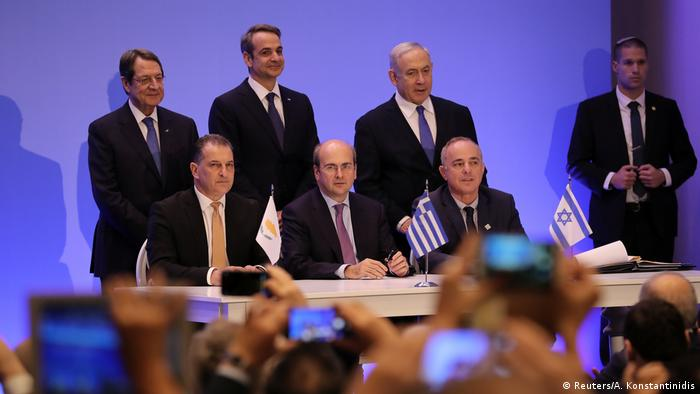 Cypriot, Greek, and Israeli energy ministers sit toghether at a Gas-Pipline-Agreement